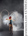 beautiful girl with red hair circus artist spinning hoops on hands 43789635