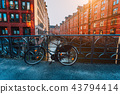 Old bicycle parked against iron hand railing on bridge in Hamburg warehouse district 43794414