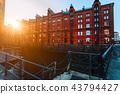 A red brick multi-storey houses of Speicherstadt Hamburg. Famous landmark of old red brick buildings 43794427