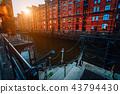 A red brick multi-storey houses of Speicherstadt Hamburg. Famous landmark of old red brick buildings 43794430