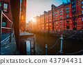 A red brick multi-storey houses of Speicherstadt Hamburg. Famous landmark of old red brick buildings 43794431