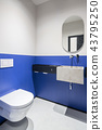 Restroom with multicolor walls and concrete sink 43795250