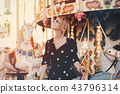 girl stay in merry go round carousel  43796314
