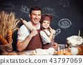 Cheerful man with adorable girl holding rolling pins 43797069