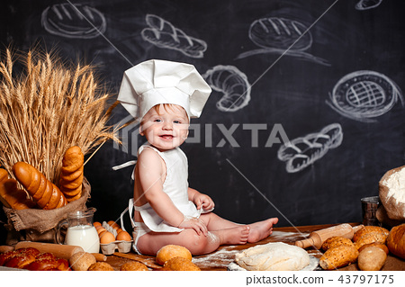 Adorable infant on table with dough 43797175