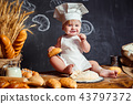 Adorable infant on table with dough 43797372