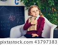 Learning concept with cute little girl holding a book 43797383
