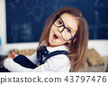 funny crazy girl student with glasses 43797476