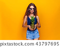 woman in swimwear isolated over yellow background holding pineapple. 43797695
