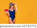 Woman in cap and swimwear hold slice of watermelon 43797772