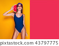 Woman in cap and swimwear hold slice of watermelon 43797775