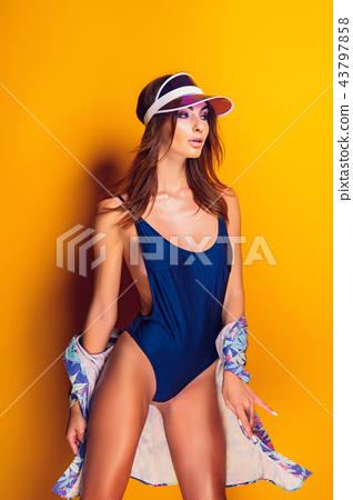 Woman in cap and swimwear 43797858