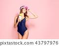 Sensual woman in swimwear with drink 43797976