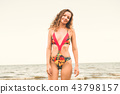 Happy young woman at beach in summer vacation. 43798157