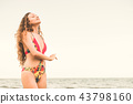 Happy young woman at beach in summer vacation. 43798160