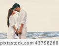Couple going honeymoon on tropical beach in summer 43798268