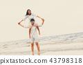Couple going honeymoon on tropical beach in summer 43798318