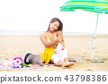 Plus size young woman sitting on the beach. 43798386