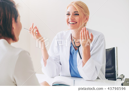 Woman Doctor and Female Patient in Hospital Office 43798596