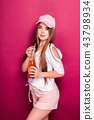 Sporty woman with cold drink 43798934