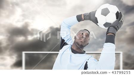 Soccer goalkeeper saving football in goal 43799255