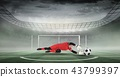 Composite image of goal keeper holding soccer ball in stadium 43799397