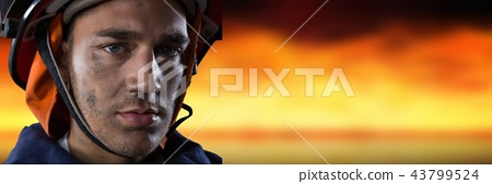 Composite image with firefighter with fire background 43799524