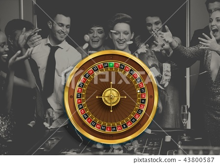 Roulette wheel and people playing in casino 43800587