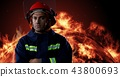 Firefighter in front of burning fire 43800693