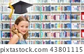 School girl in education library with graduation hat 43801115