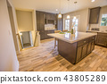 Kitchen island with nice countertop and chairs 43805289