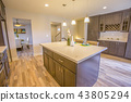 Island with marble countertop in a kitchen 43805294