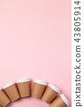 A cardboard cups of coffee or tea. 43805914