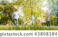 Family playing badminton on a meadow in summer 43808384