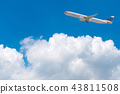 Commercial airplane flying over bright blue sky 43811508