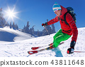 Skier skiing downhill in high mountains  43811648