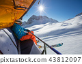 Skier sitting at ski lift. 43812097