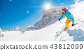 Skier skiing downhill in high mountains 43812099