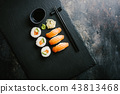 Sushi served on plate on dark table 43813468