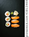 Sushi served on plate on dark table 43813469