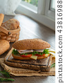 sandwiches with ham, tomatoes, cheese burger 43816988