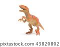 Plastic velociraptor toy isolated on white 43820802