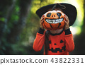 Happy Halloween! horrible creepy child girl in  pumpkin costume 43822331