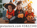 happy Halloween! a group of children in suits and with pumpkins 43822340