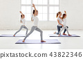 practicing engaged in gymnastics and yoga with  teacher 43822346