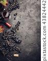 Wine composition on dark rustic background 43824442