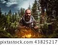 Cruel terrorist in uniform with gun in hands 43825217