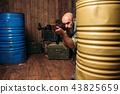 Terrorist aiming from a kalashnikov rifle 43825659