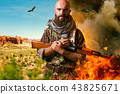 Bearded terrorist in uniform holds rifle in hands 43825671
