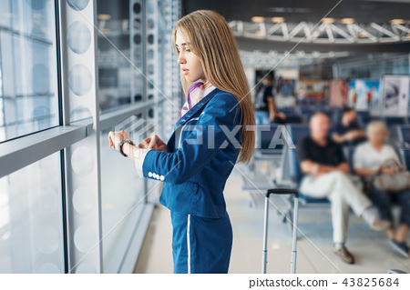 Stewardess legs and suitcase in airport hall 43825684